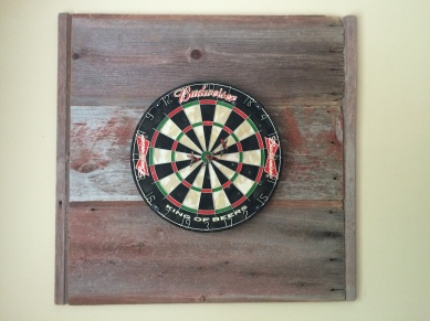 Dartboard with barn wood backing