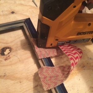 Staple burlap to create a loop for hanging
