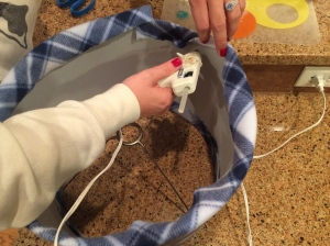 Step 4- Glue the fabric on the inside of the lampshade